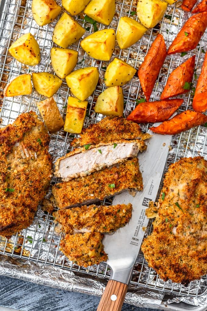 breaded pork chops sheet pan dinner with potatoes and carrots