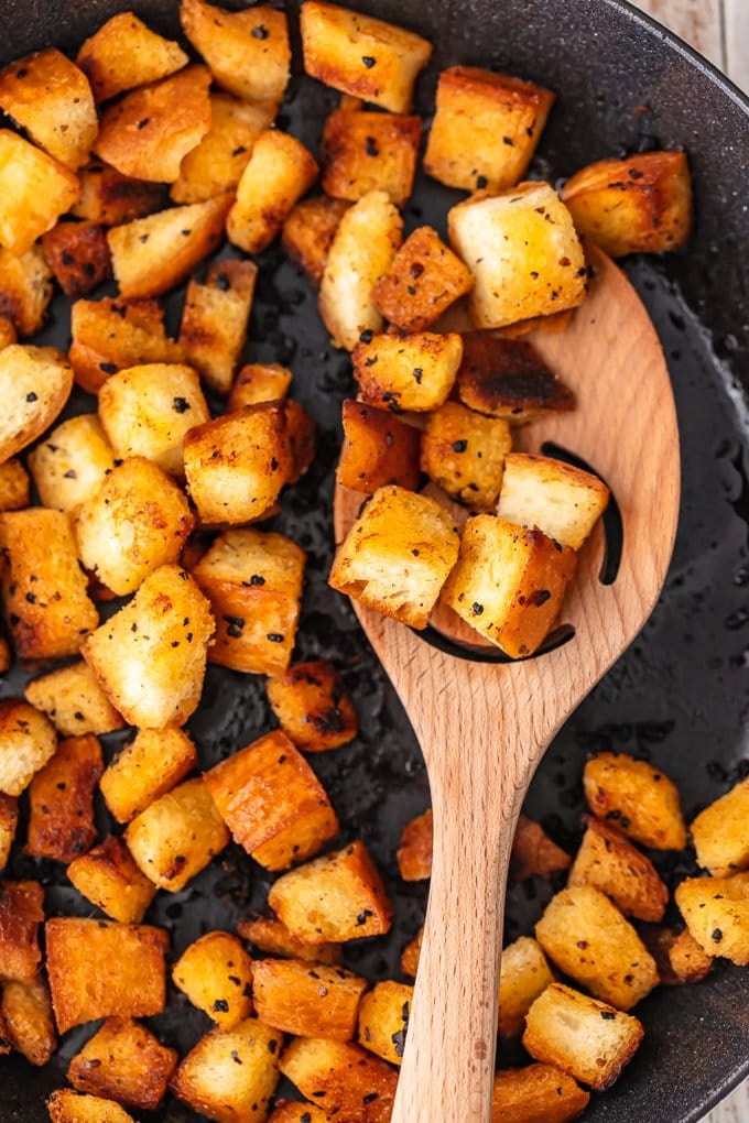 garlic croutons frying in a skillet