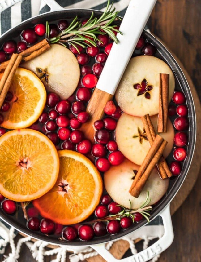 Spiced Cider is a holiday must! Warm things up this season with this delicious Cranberry Apple Hot Cider Recipe. It's easy, it's festive, and it's the perfect drink to serve for any Christmas party. Make it without alcohol for the whole family, or make it spiked hot apple cider for the adults. Either way, the flavor is just perfect!