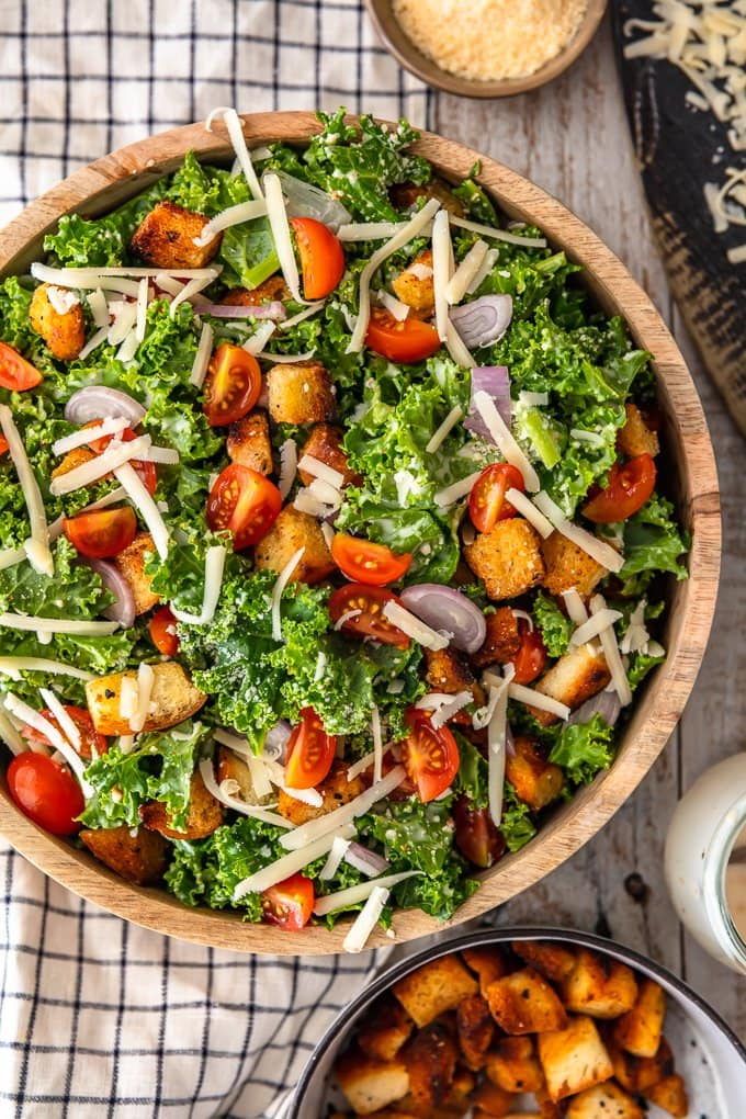 A large bowl filled with kale caesar salad, viewed from above