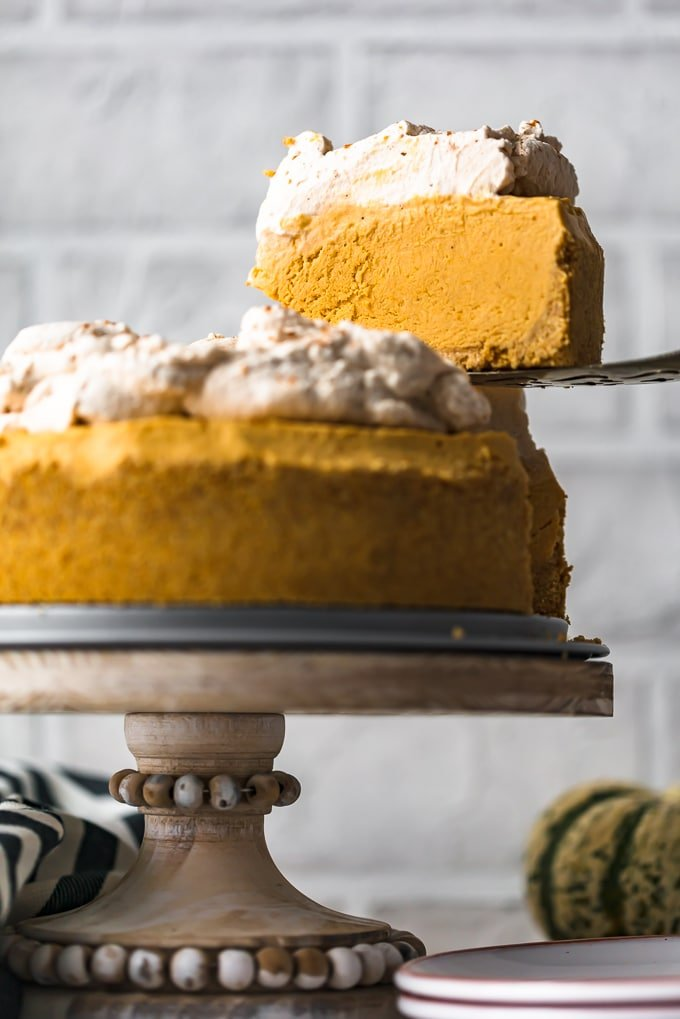 Pumpkin pie cheesecake on a cake stand