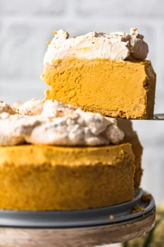 Pumpkin Pie Cheesecake is the perfect fall dessert, made with a graham cracker crust and topped off with pumpkin spice whipped cream. This no bake pumpkin cheesecake recipe is so easy to make. You definitely want this at your holiday feast!