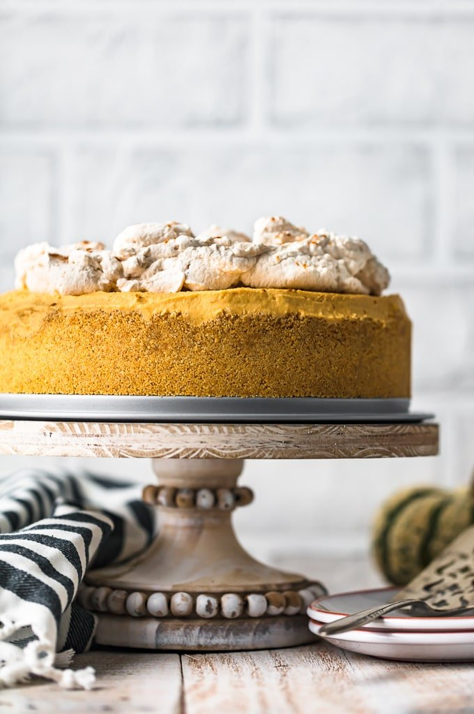 No Bake Pumpkin Cheesecake on a cake stand