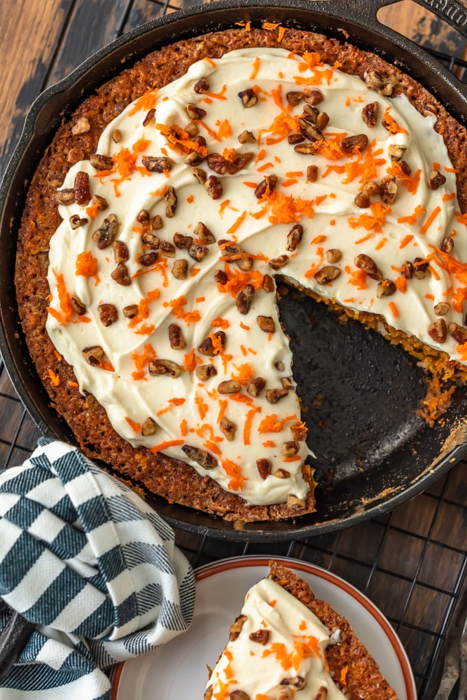 Carrot cake with pineapple in a skillet, with one slice taken out