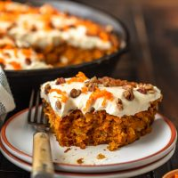 Skillet Carrot Cake is the perfect way to make this delicious dessert without an oven. This easy carrot cake recipe with pineapple is so moist, so flavorful, and so simple! And we're topping it off with the absolute best cream cheese frosting for carrot cake, because it wouldn't be complete without it!