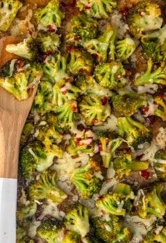 spicy cheesy broccoli on a baking dish