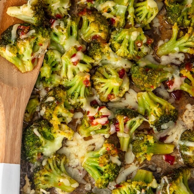 spicy cheesy broccoli on a baking dish