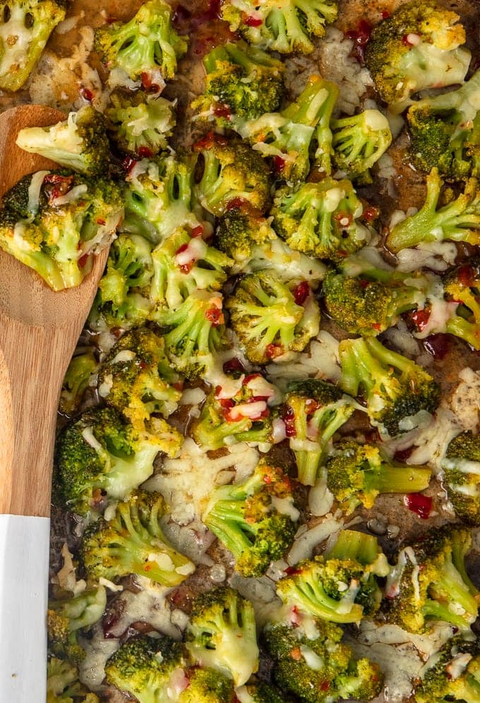 broccoli on a dish with wooden spoon