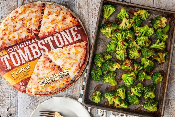 sheet pan of broccoli next to tombstone frozen pizza