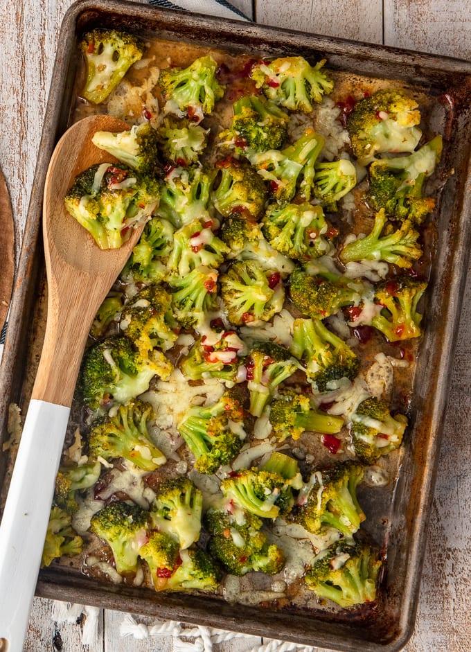 spicy cheesy broccoli on a baking sheet