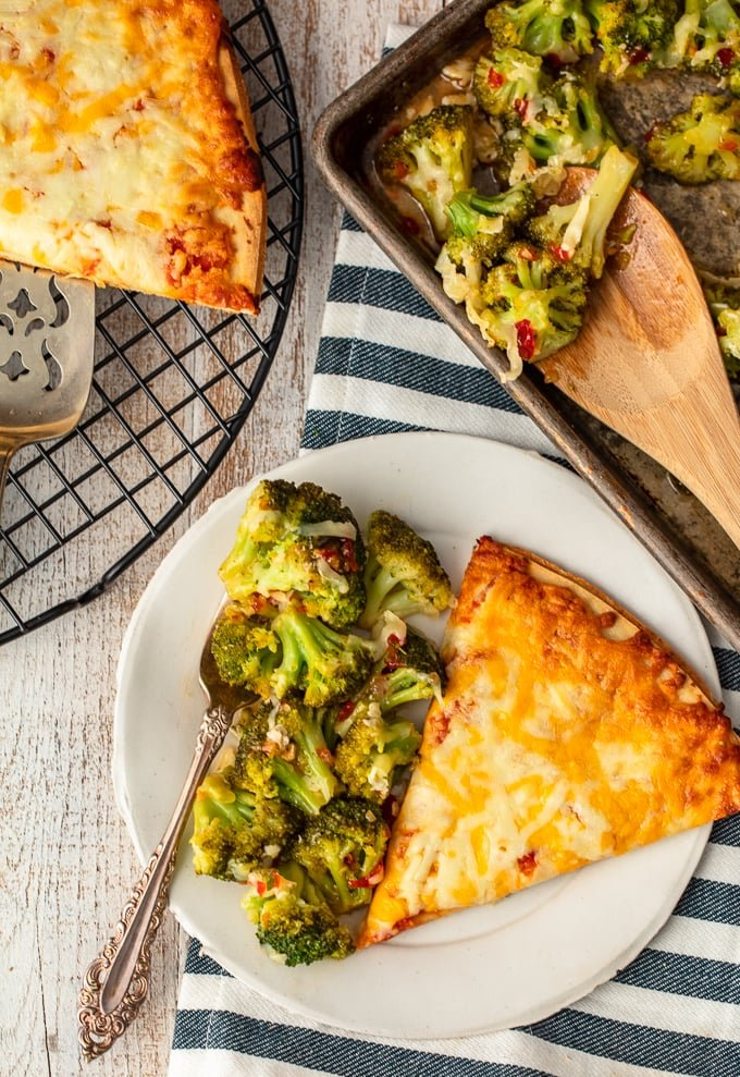 cheese pizza and broccoli on a plate