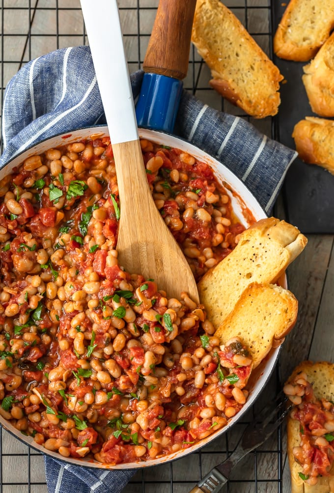 white beans with garlic and tomatoes in a pan with bread