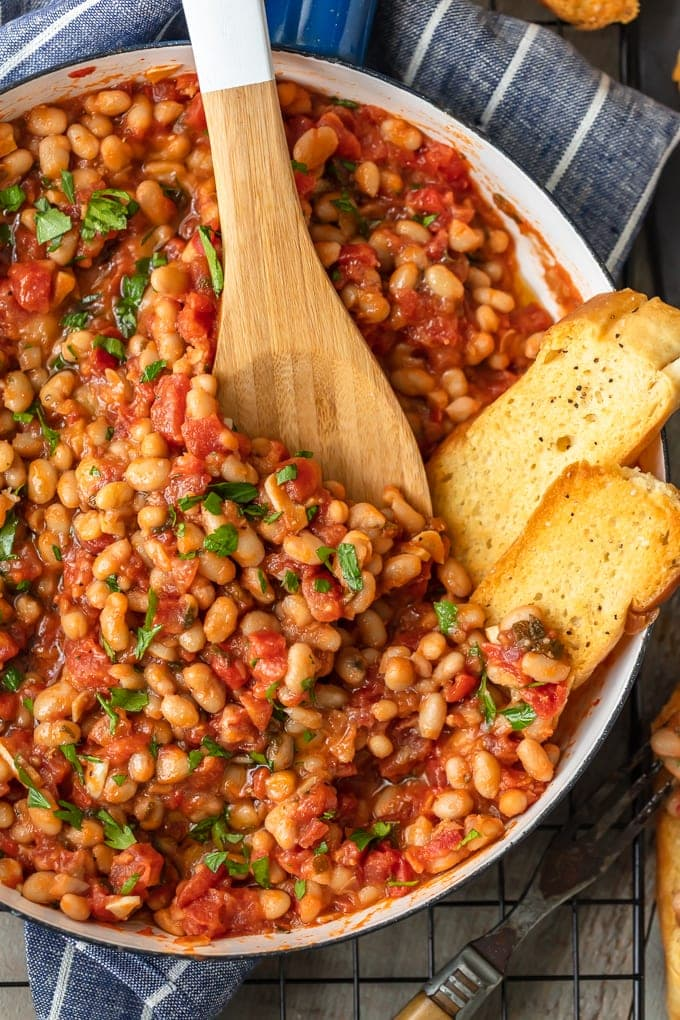 white beans with tomatoes and garlic in a large skillet