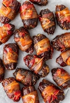 This Bacon Wrapped Dates recipe is one tasty appetizer! Everyone loves a good bacon wrapped recipe, and these bacon wrapped dates with goat cheese and pecans are out of this world. They're perfect for game day and New Year's Eve!