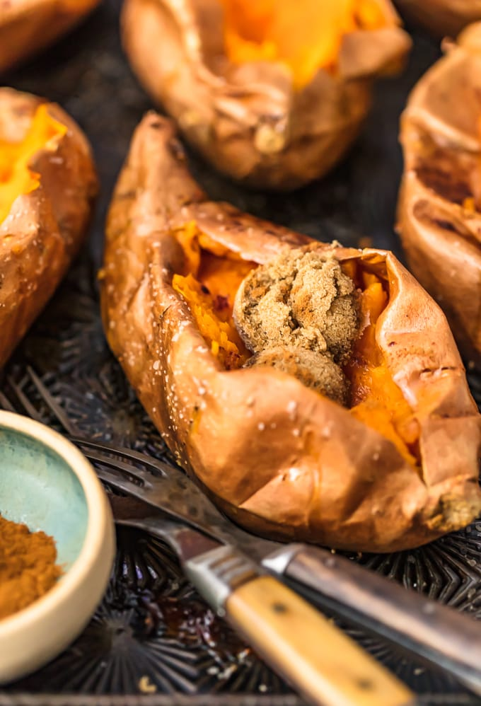the perfect baked sweet potato filled with brown sugar, cinnamon, and butter