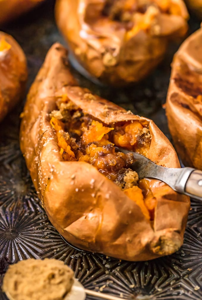 how to bake sweet potatoes: a sweet potato filled with cinnamon sugar and butter
