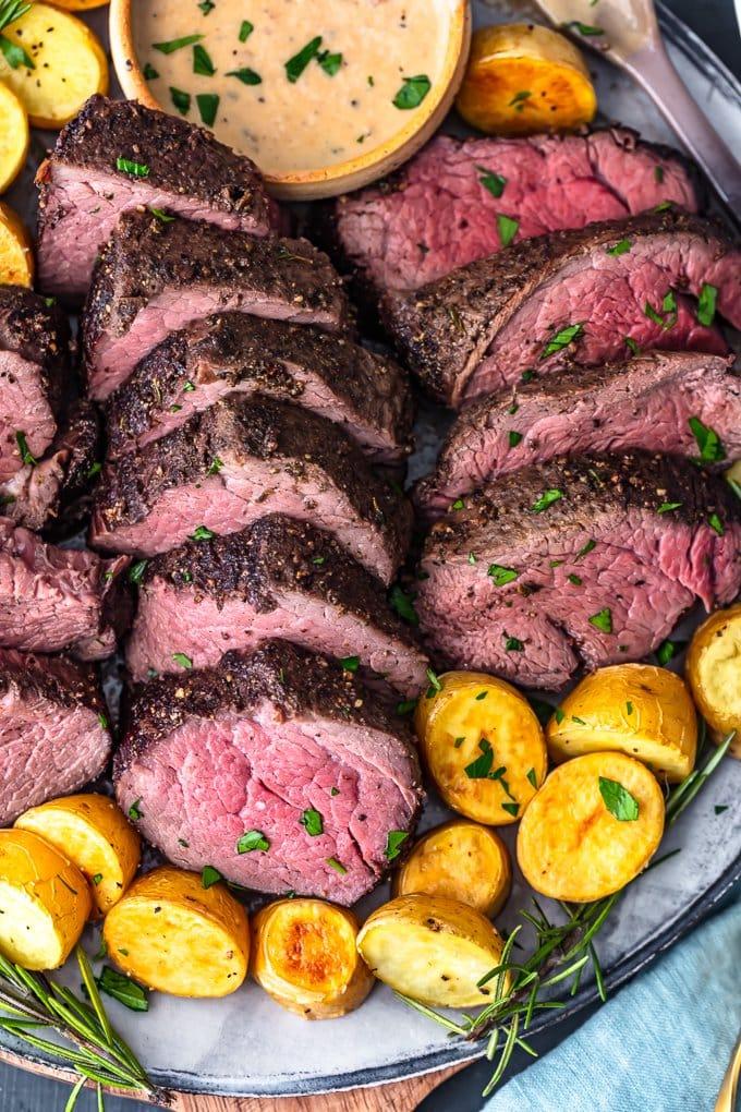 overhead view of sliced beef tenderloin on a plate