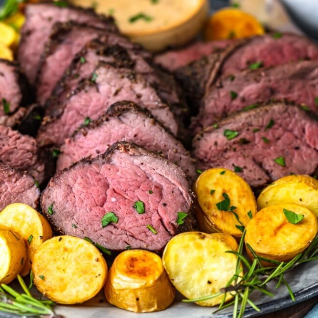 sliced beef tenderloin and potatoes on a plate