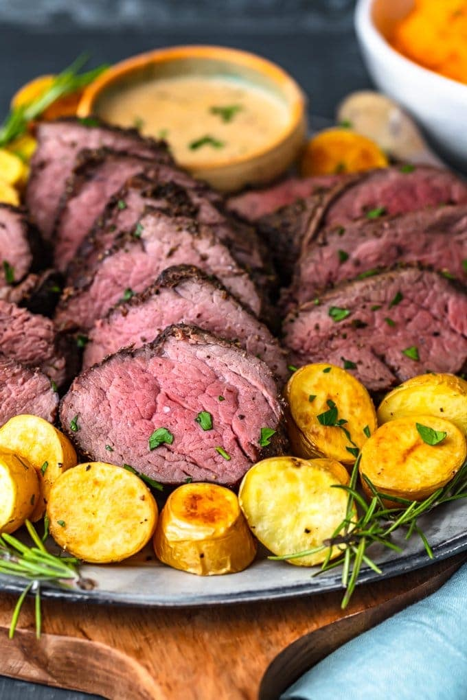 a plate of beef tenderloin with potatoes