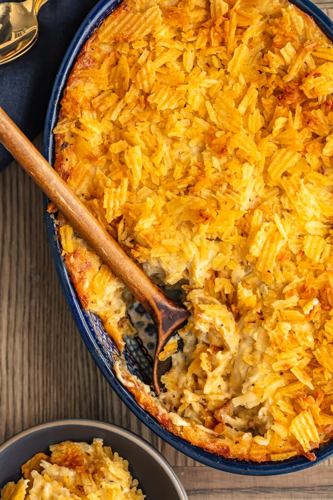 cheesy hash brown potato casserole in a blue dish