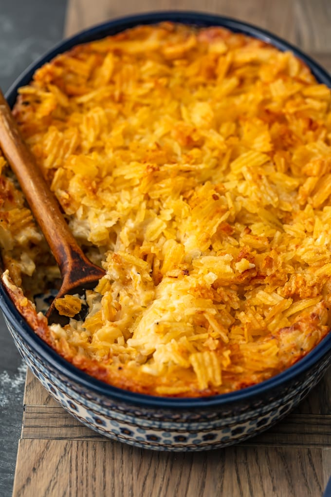 blue casserole dish filled with cheesy potatoes