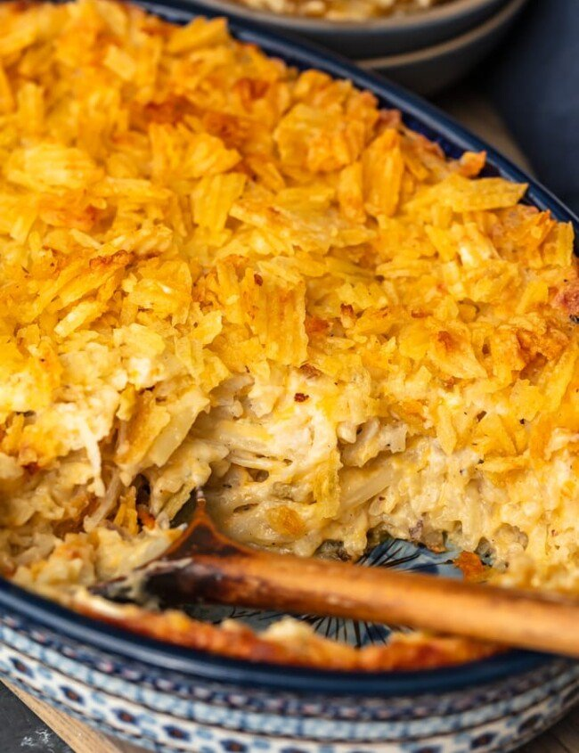 Cheesy Potato Casserole is the ideal holiday side dish recipe for anyone that loves cheese and potatoes. This hash brown potato casserole recipe is super easy, super cheesy, and topped off with a crunchy potato chip topping!