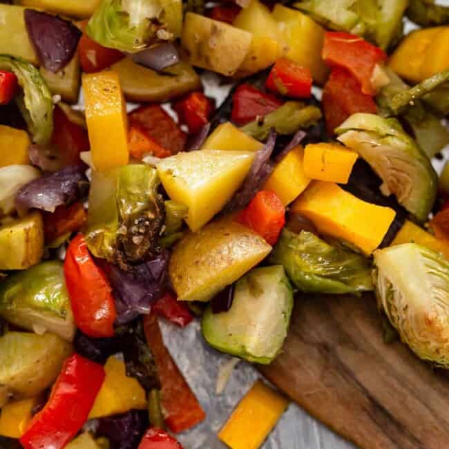 close up view of chopped roasted vegetables on a pan