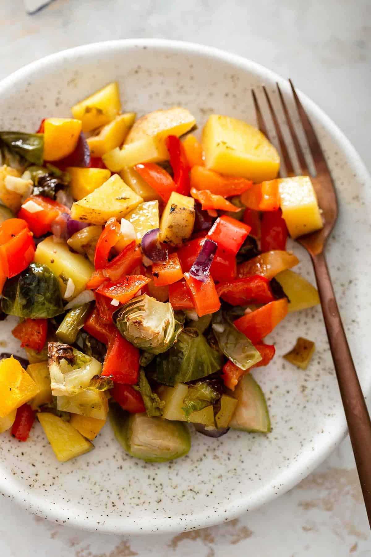 cooked brussels sprouts, squash, potatoes on a plate