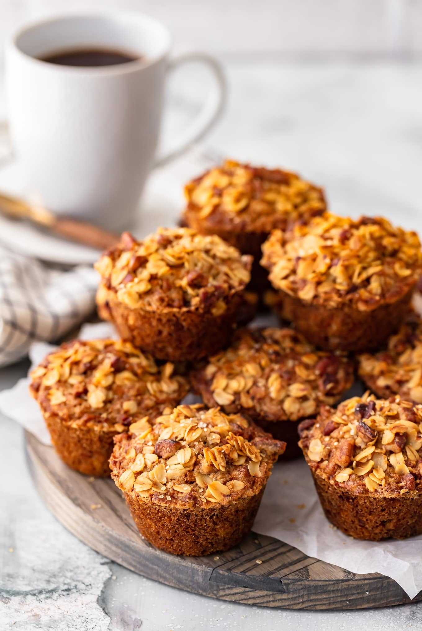 breakfast muffins arranged in a stack, next to a cup of coffee