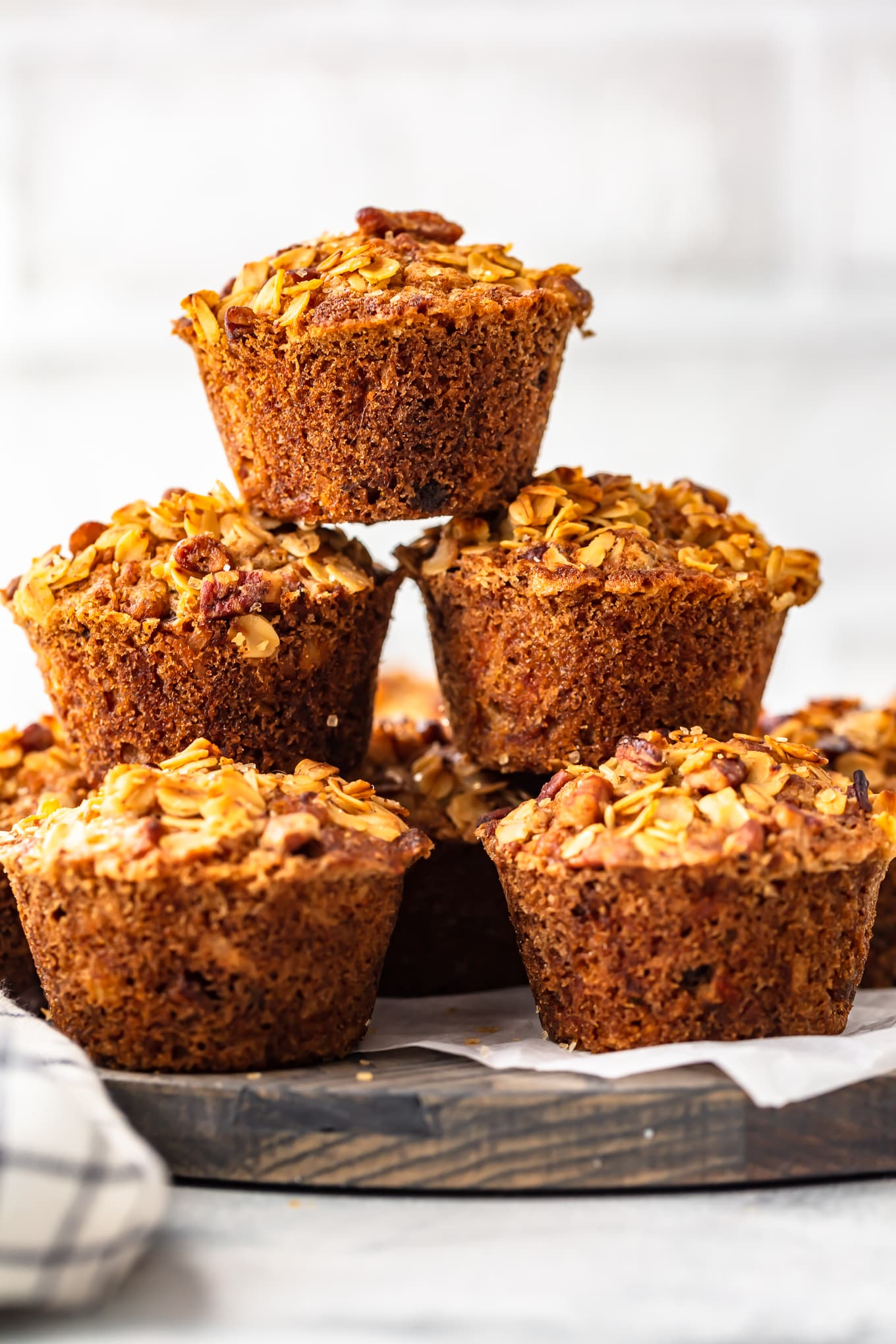 a stack of carrot raisin muffins