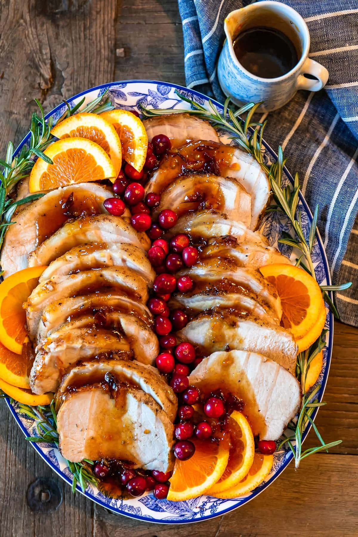 orange cranberry pork loin roast on a serving platter