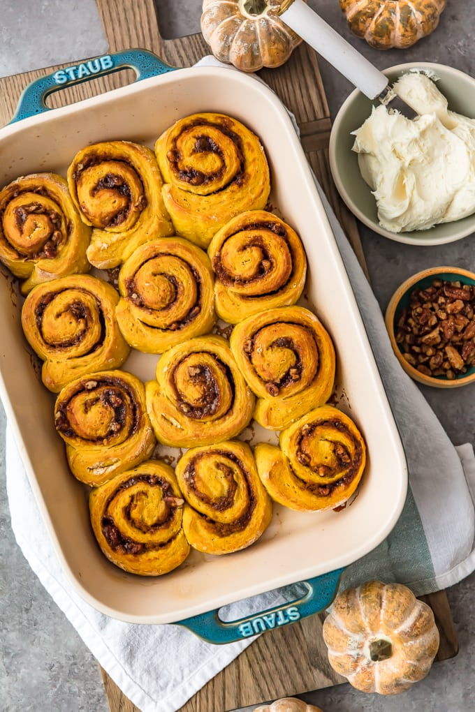 Overhead shot of pumpkin cinnamon rolls in a baking pan