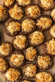 Sausage Stuffed Mushrooms are cheesy, savory, and so delicious! This easy, cheesy sausage stuffed mushroom recipe is the perfect appetizer for holidays, game day, or any special occasion. Mushroom caps are stuffed full of cheese, sausage, onion, and more to create the most amazing flavor!