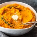 Savory Mashed Sweet Potatoes are the perfect easy side dish for Thanksgiving and beyond. This sweet potato mash recipe is so creamy and delicious! Find out how to make mashed sweet potatoes with this easy mashed sweet potatoes recipe, and add them to your holiday table.