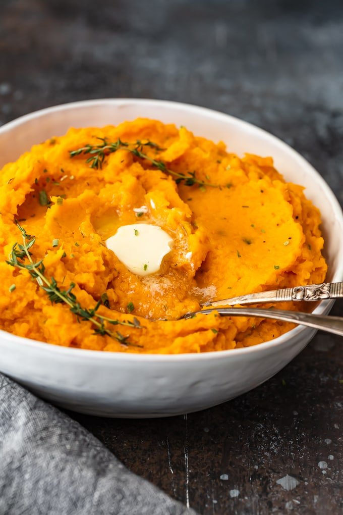 Savory mashed sweet potatoes in a white bowl