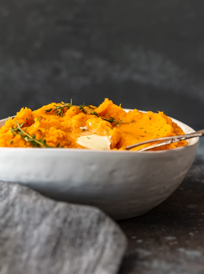 mashed sweet potatoes in a white bowl, viewed from the side