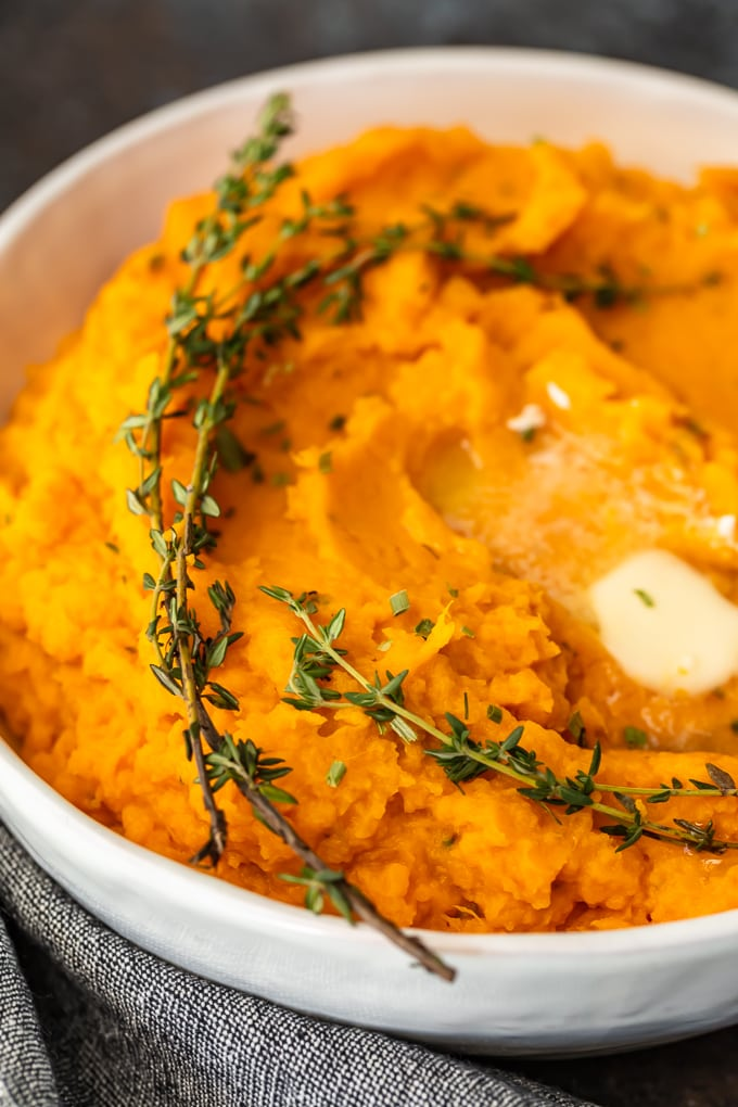 close up on a bowl of savory mashed sweet potatoes