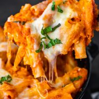 Baked Ziti is a simple and delicious baked pasta dish that never fails to please. This easy baked ziti recipe is extra creamy and cheesy! Everything bakes together into something so tasty...the best baked ziti recipe ever!