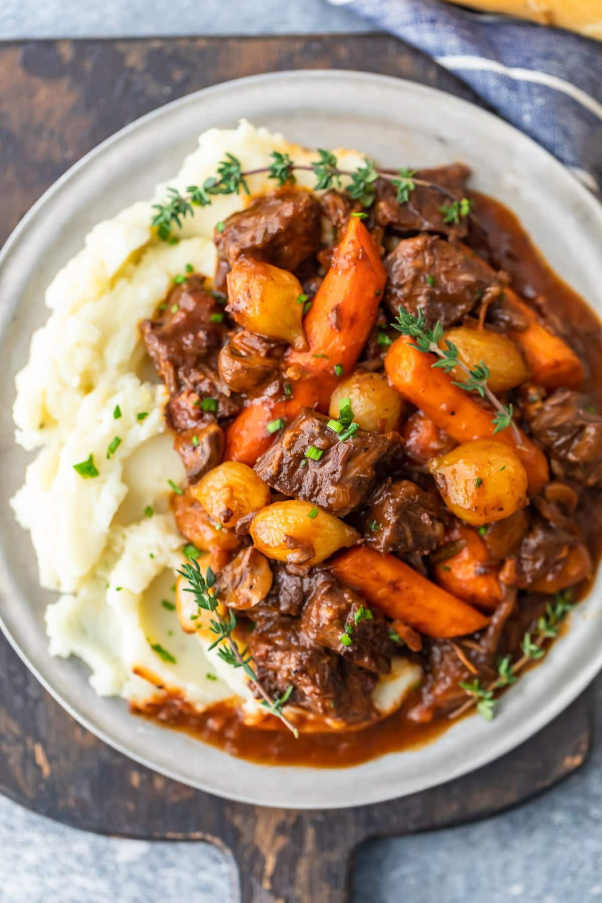 a plate of beef bourguignon with mashed potatoes