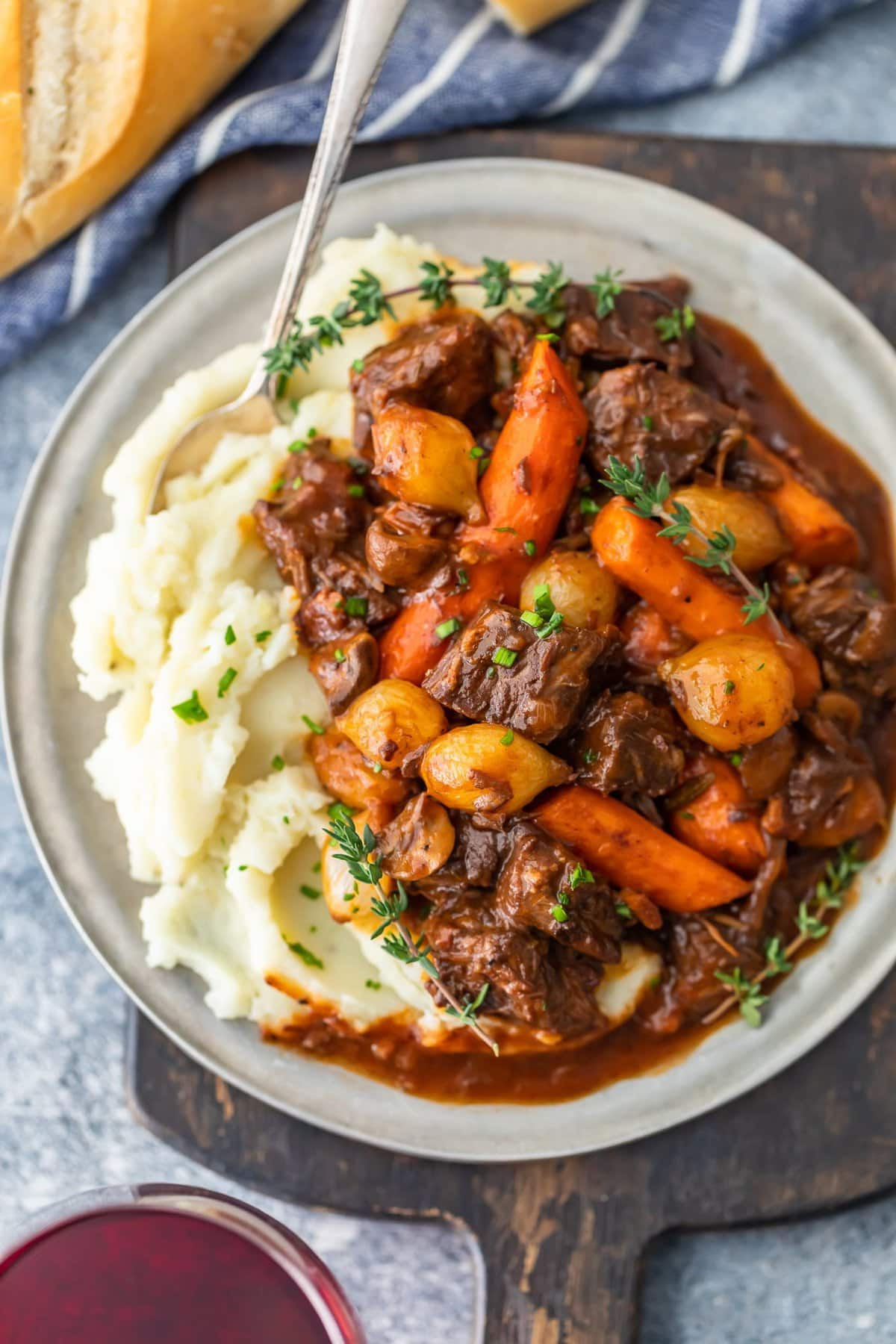 beef burgundy recipe on a plate with mashed potatoes