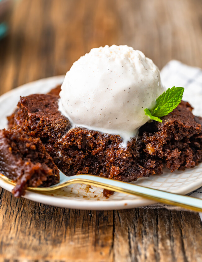 gingerbread pudding cake topped with ice cream