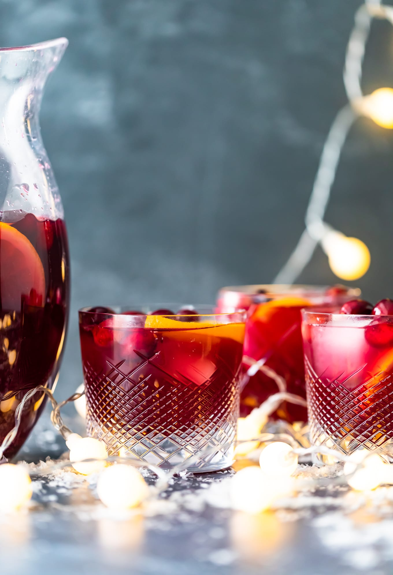 glasses of Christmas sangria with Christmas lights in the background