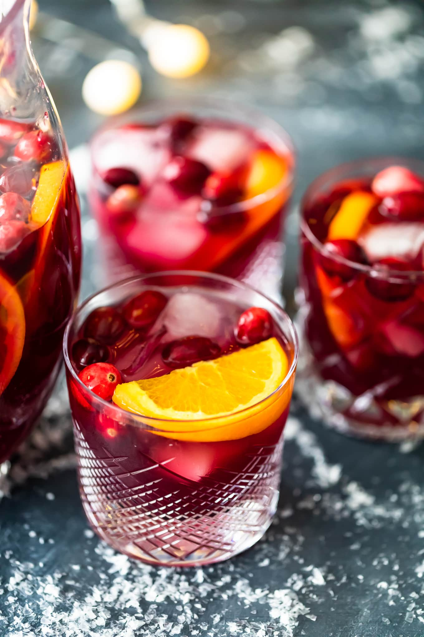 three glasses of orange cranberry sangria