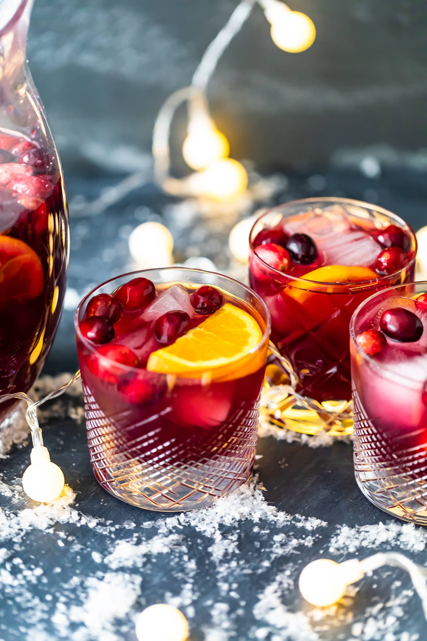 short glasses filled with orange cranberry sangria