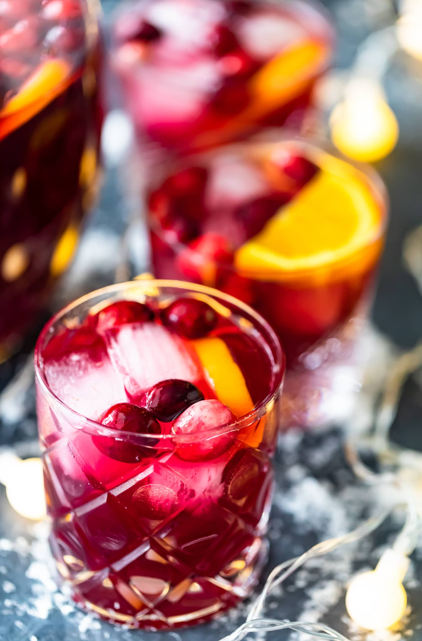 glasses of orange cranberry sangria over ice