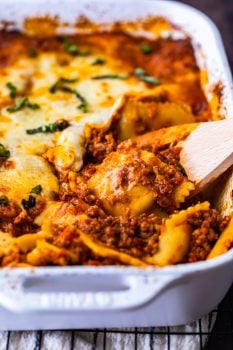 Ravioli Lasagna is a delicious mix of two favorite pasta dishes. This cheesy ravioli casserole is made with layers of ravioli, marinara sauce mixed with Italian sausage, and plenty of cheese. It's an easy lasagna recipe with an extra kick! Everyone will love this ravioli lasagna bake.