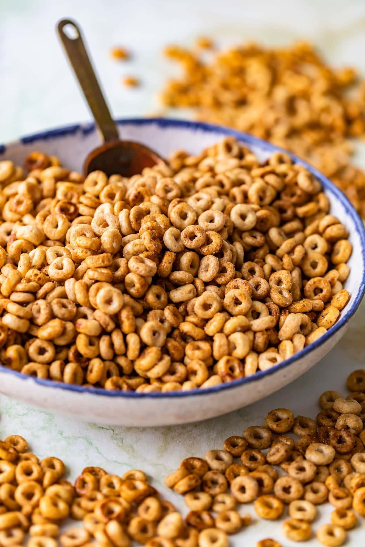a bowl of sweet and salty cheerios with a scoop