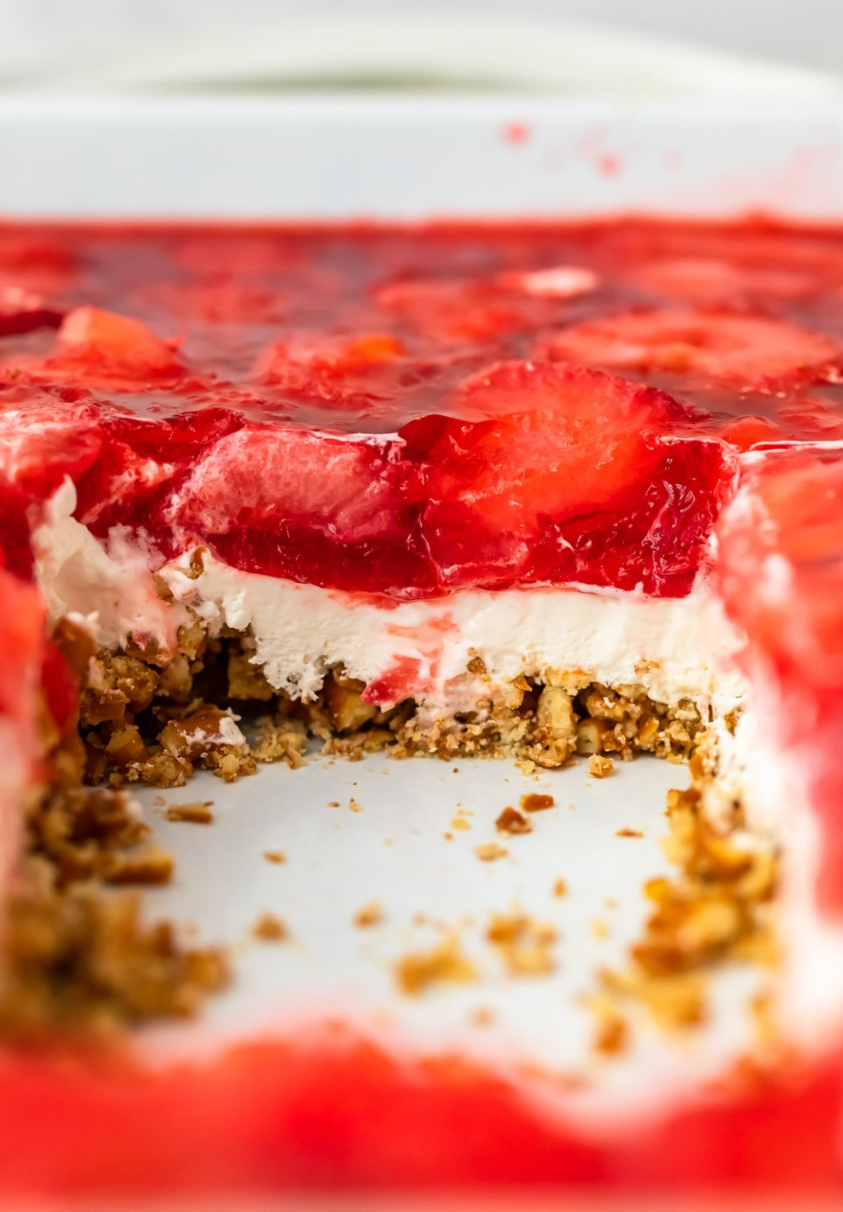 Strawberry Pretzel Salad in a baking dish with a piece cut out