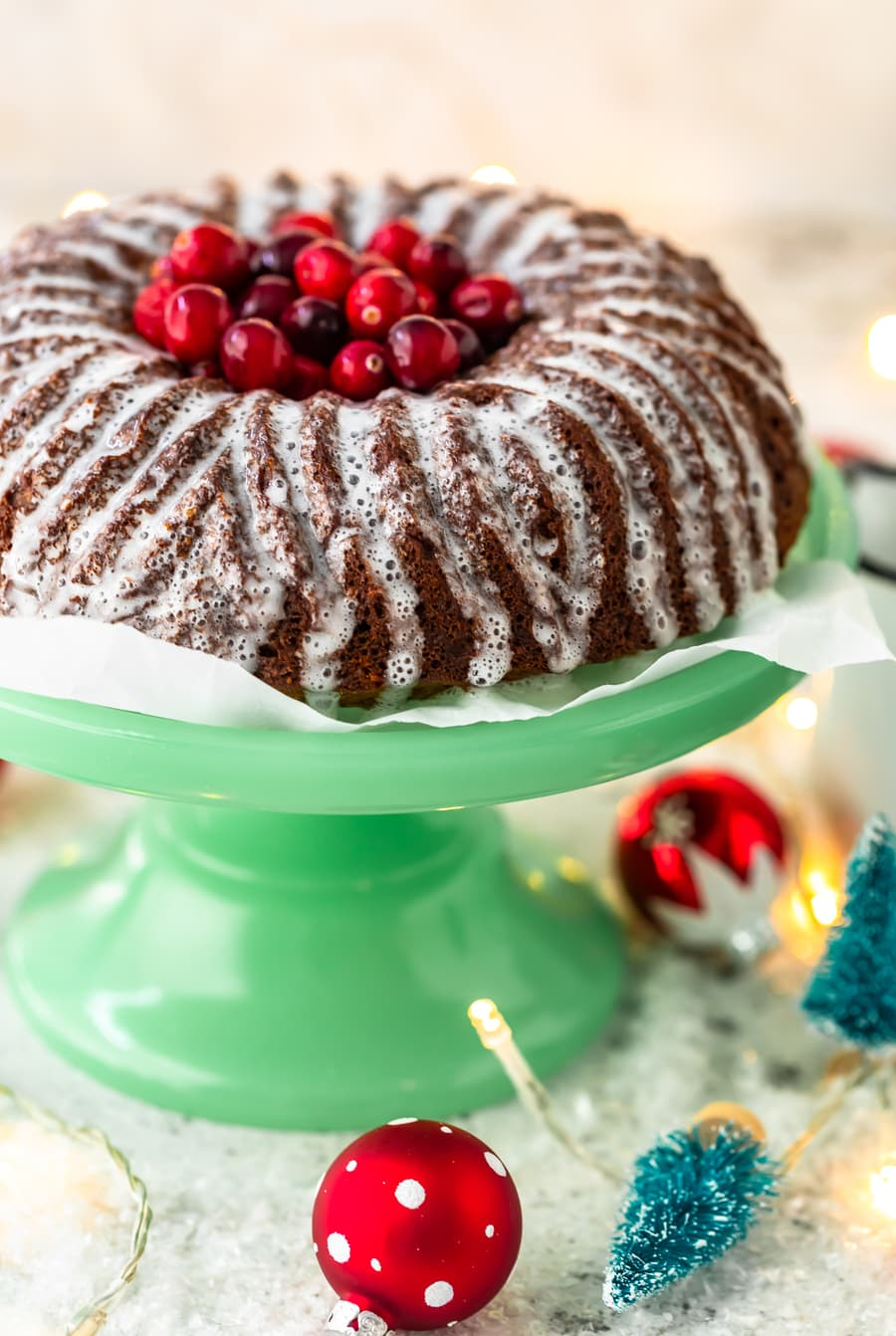 gingerbread cake with lemon glaze, topped with fresh cranberries