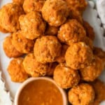 This Sausage Cheese Balls recipe puts a sweet and spicy twist on a classic appetizer. These easy sausage balls are made with cheese, sweet potato, and chorizo, and they taste amazing! Dip these Sweet Potato Sausage Balls in a spicy marmalade sauce for the final touch.